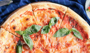 Image of a Margherita pizza on a wooden board